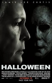 A theatrical poster of Halloween, 2018. The image shows an older Laurie Strode, played by Jamie Lee Curtis, in profile in front of the masked killer Michael Myers.